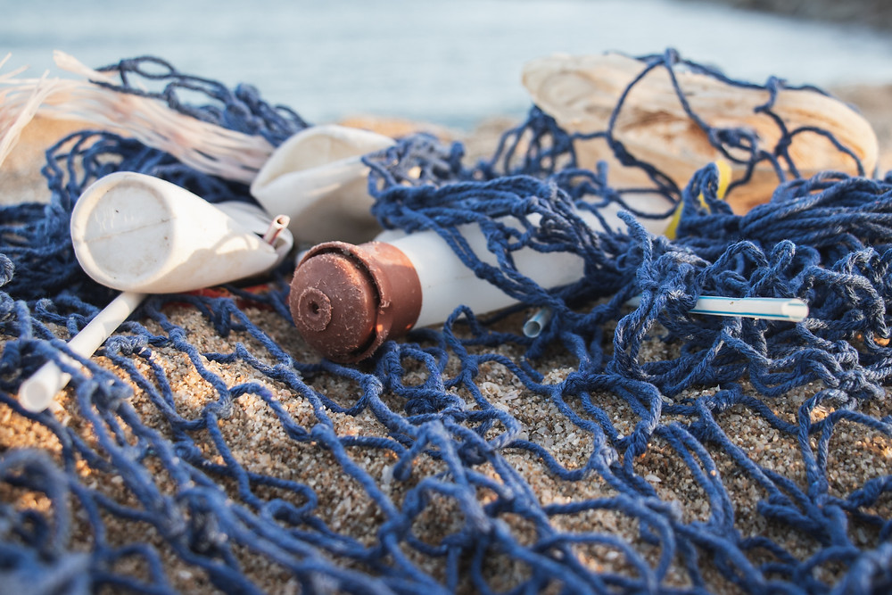 Plastic waste caught on fishermen net on the beach