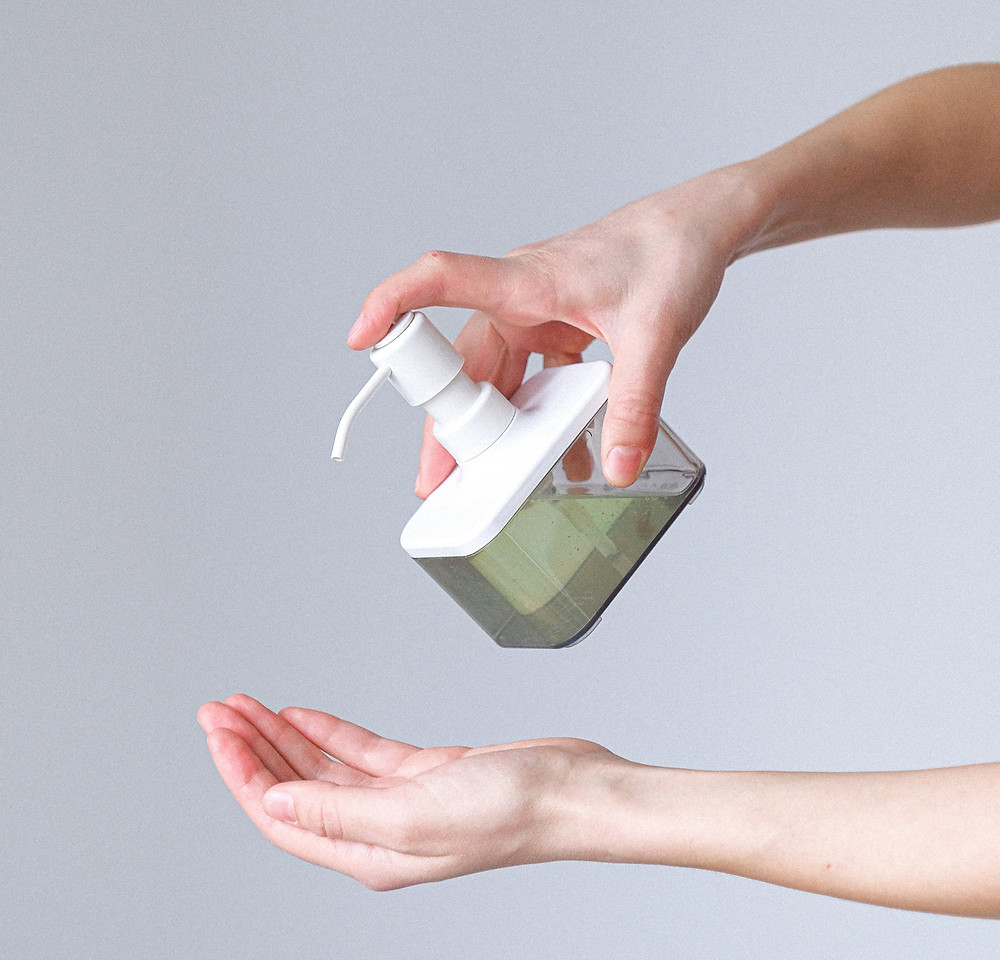 Person applying soap to hands for Covid 19 prevention