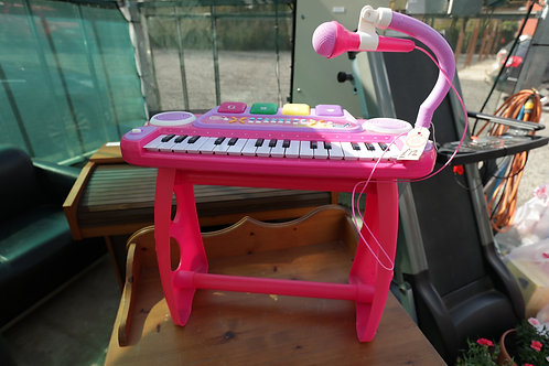 876. Toy Piano and Seat. Battery Operated