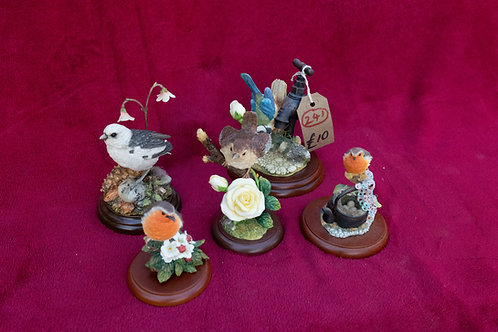 241. Bird Ornaments on Plinths.