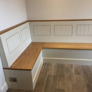 Corner seat with hidden underseat storage