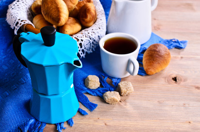 Coffee maker blue color on the backgroun