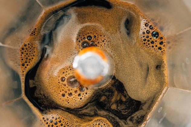 Process of brewing coffee in a moka pot,