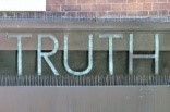 the word truth in chalk on a city wall