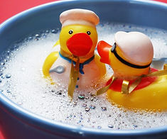 rubber ducks i a bowl of water