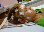 woman lying down attached to electrodes