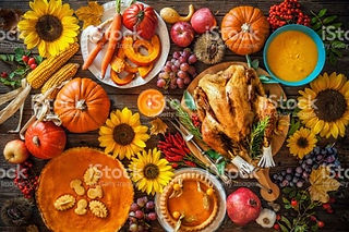 Picture of thanksgiving foods such as roast turkey, pumpkins, and squashes.