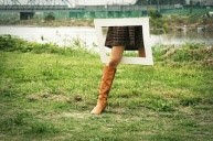 a woman has stuck her leg though a picture frame – no glass!