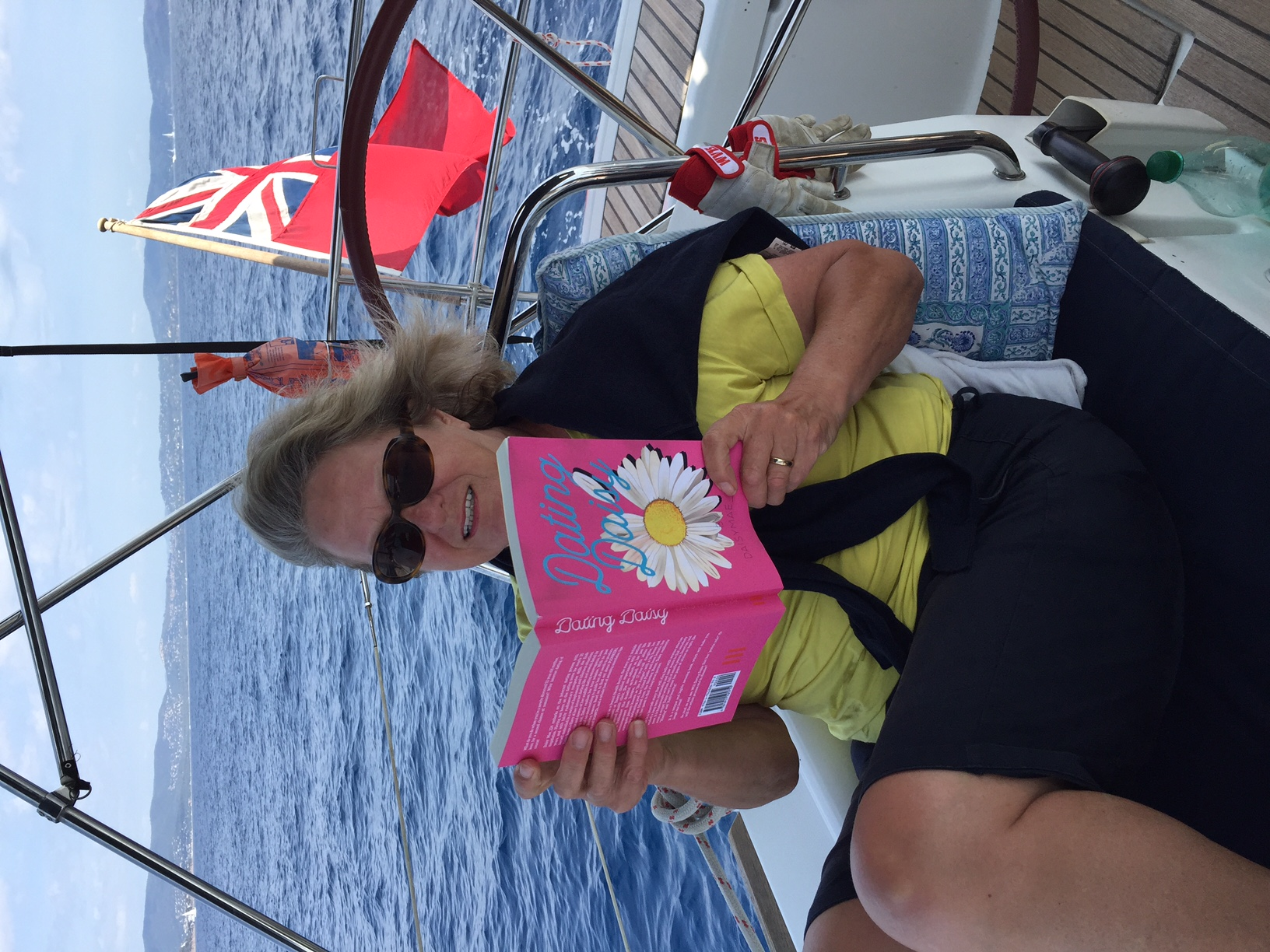 Alison reads Dating Daisy on her yacht in the South of France!