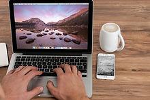 mae hands on a open laptop keyboard