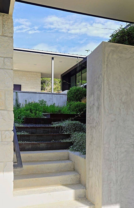 Texas-modern-house-steel-edge-stairs-sloped-landscaping-lankerani-architecture