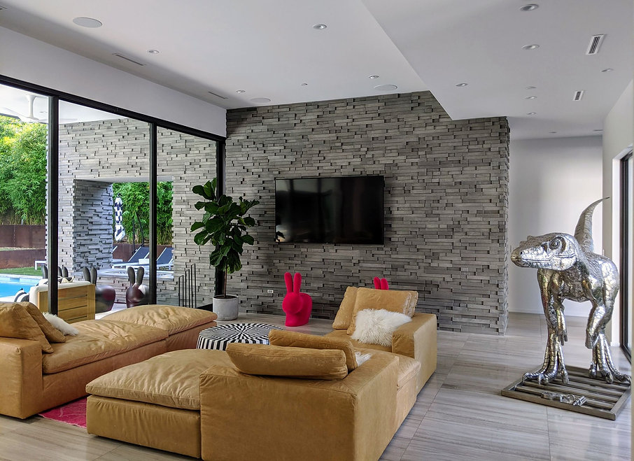 modern-living-room-dinosaus-sculpture-large-windows-stone-tile-floors-large-windows