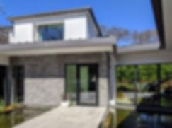 Modern-pivot-front-door-water-feature