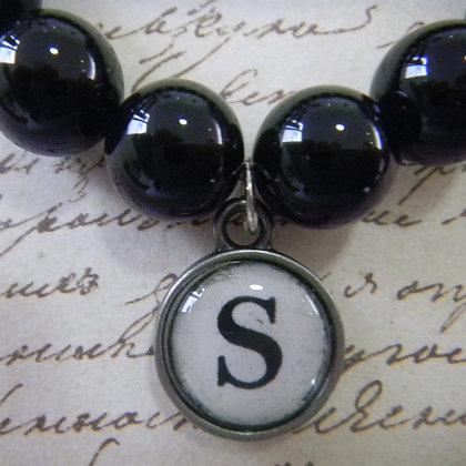 Black onyx bracelet with typewriter style letter