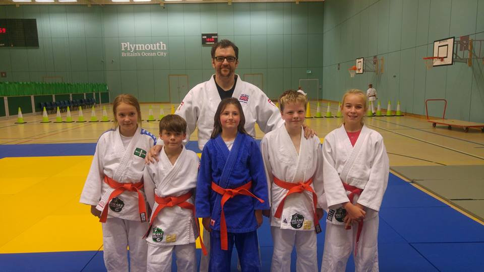 our new orange belts, with some bloke at the back