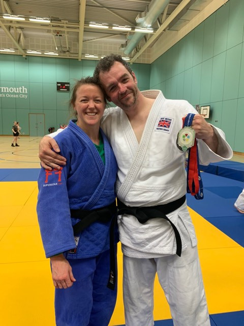 Ross showing off his medals to Megan (she looks impressed!)