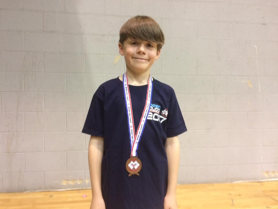 Jake with his medal