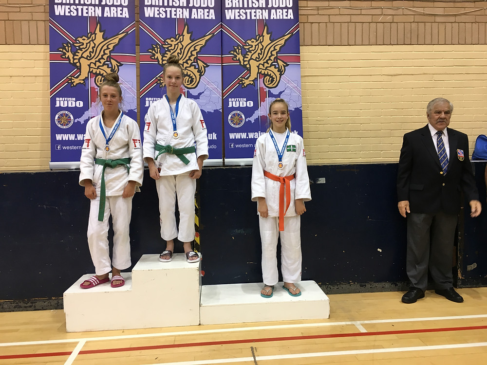 Maria on the poduim after the first round of fights sh was in joint gold medal postion