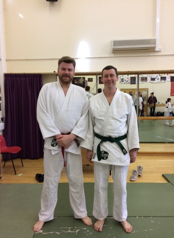 JP(James) gets his red belt, pictured with Dan
