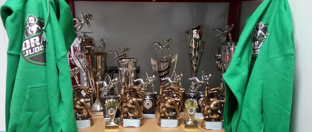 all of our trophies and Champion hoodies