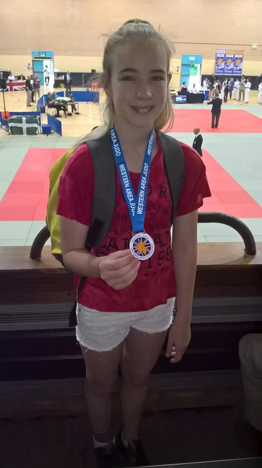 Maria with her medal