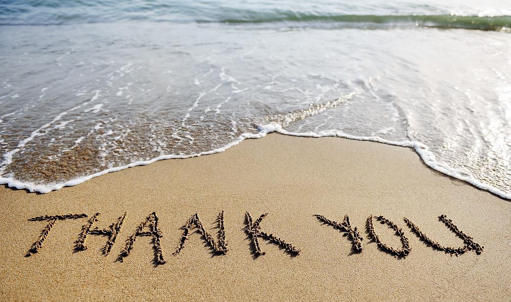 Thank You Word Drawn On The Beach Sand.jpg
