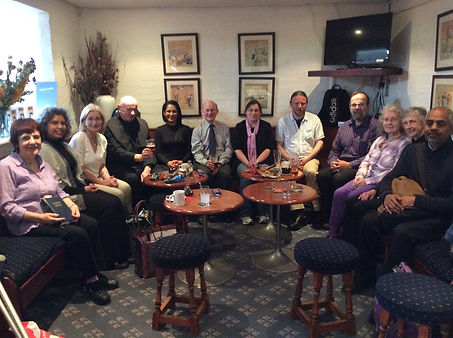 Choir members relaxing in the Benet Bar after singing Sunday Mass