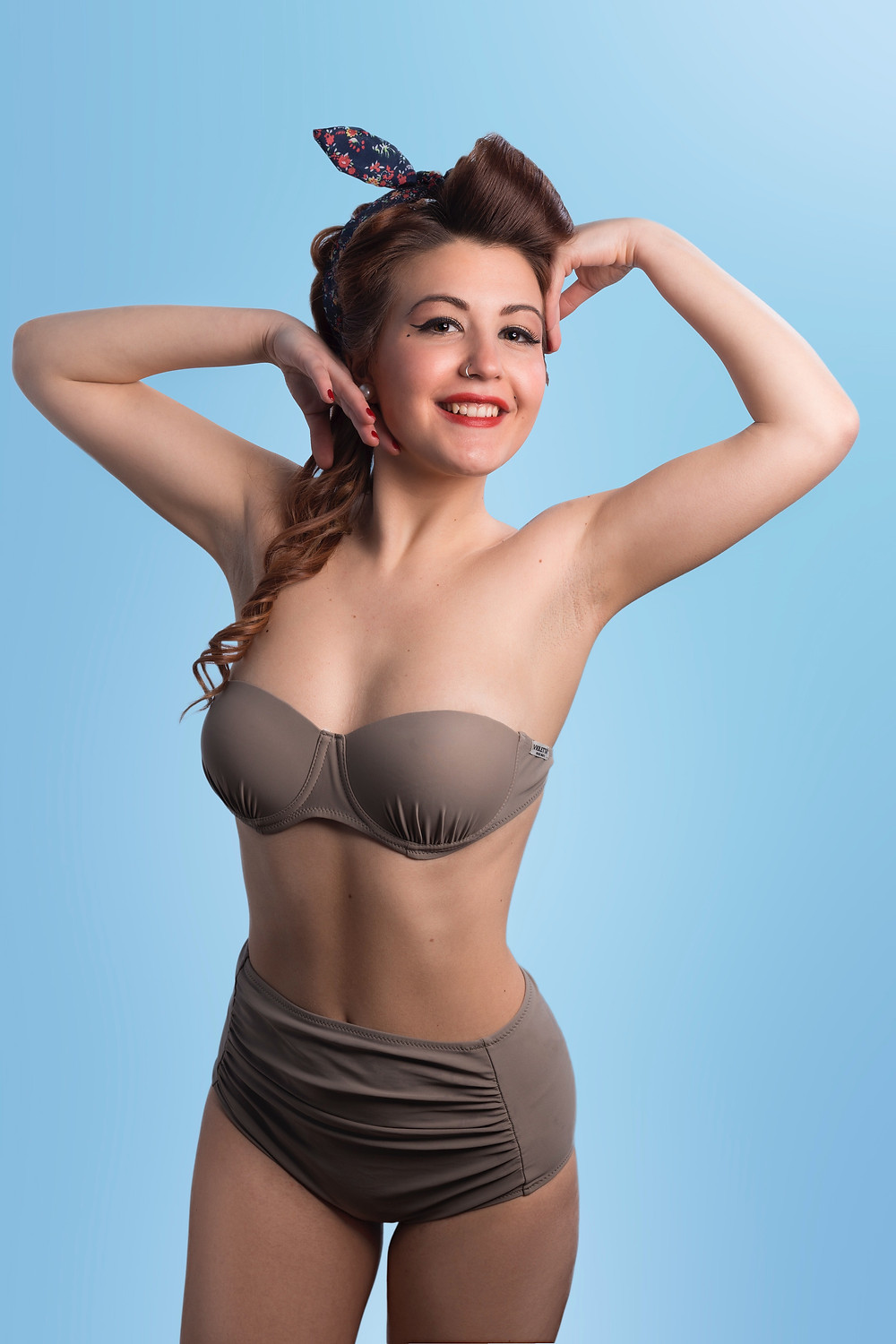 cute pin up girl wearing matching vintage lingerie