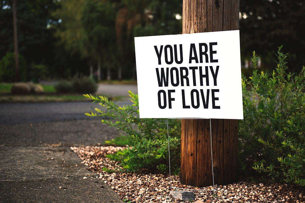 motivational sign for self love on side of the road