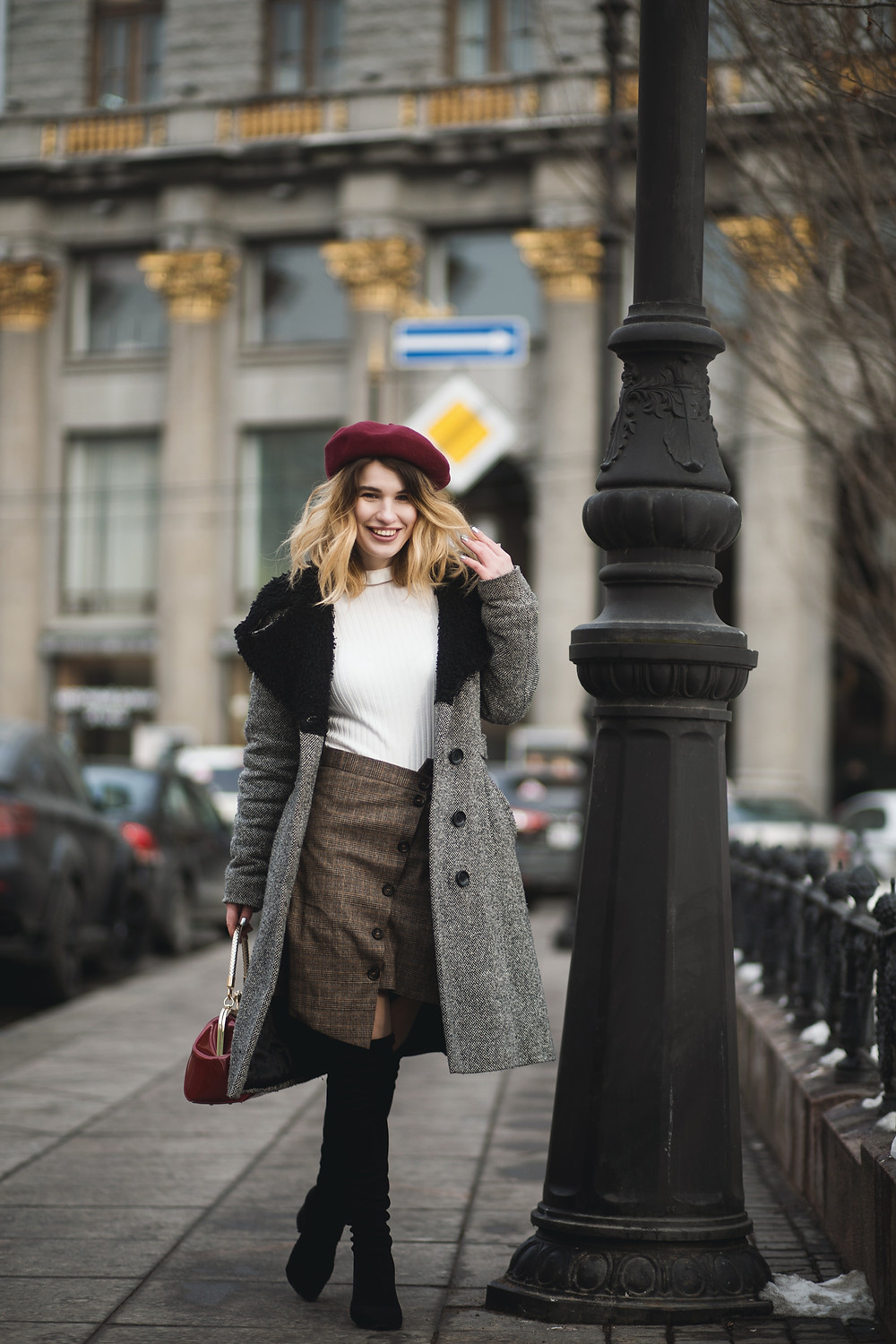 preppy and stylish woman in a gorgeous coat with fur trim