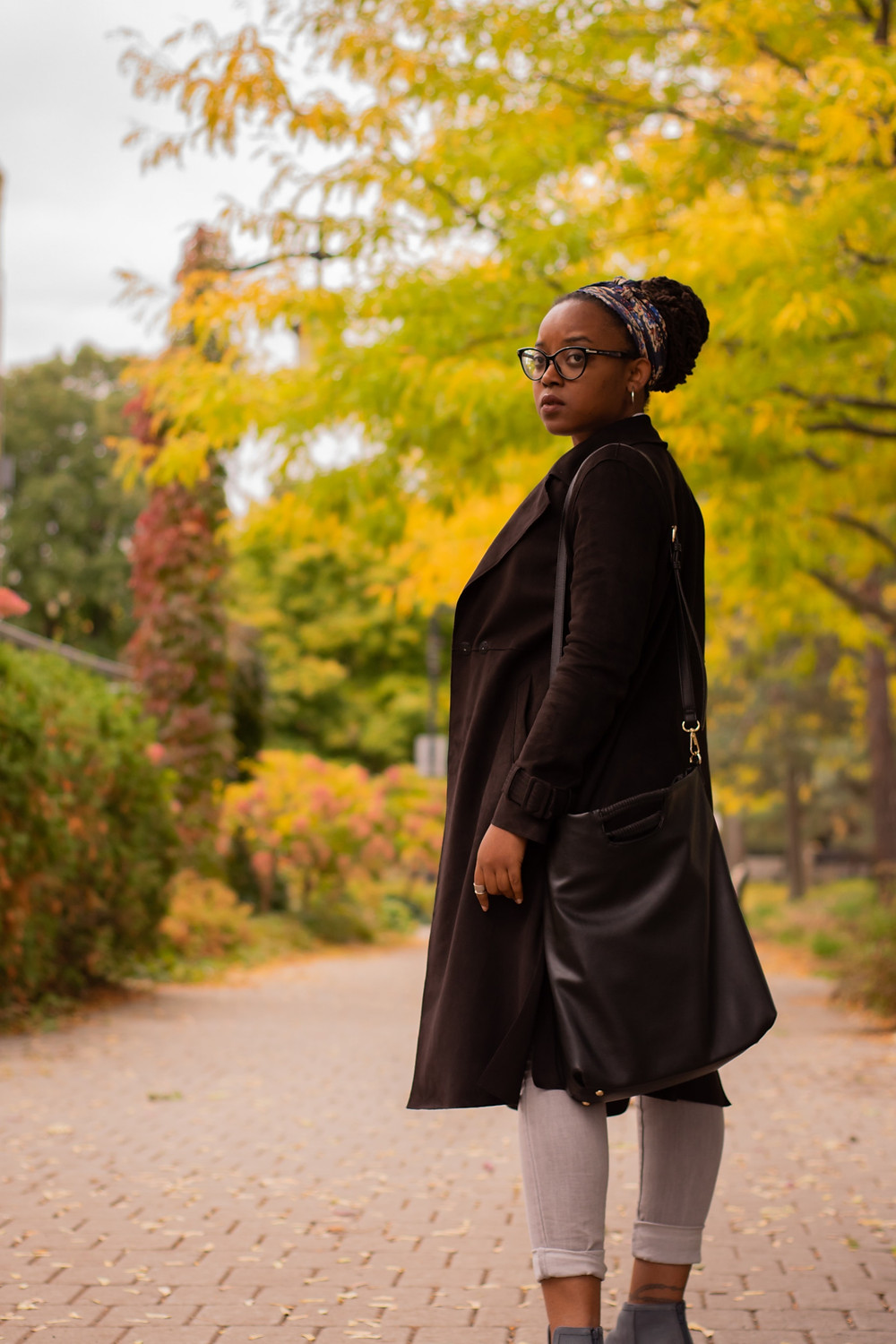 cool black woman in stylish brown coat