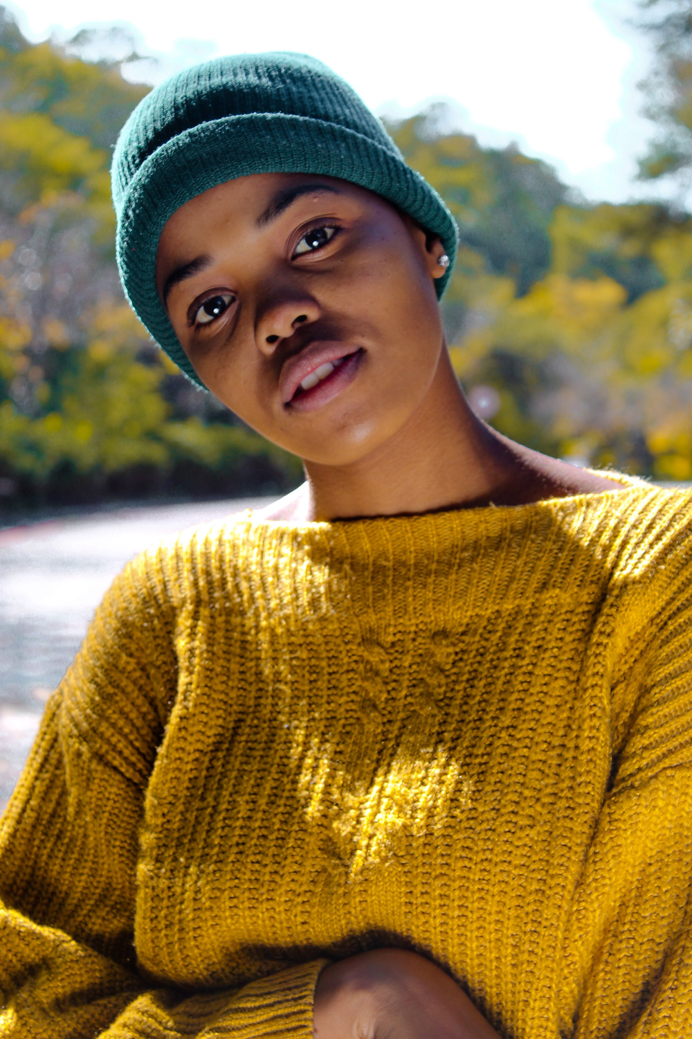 hipster girl wearing a cool beanie and mustard jumper