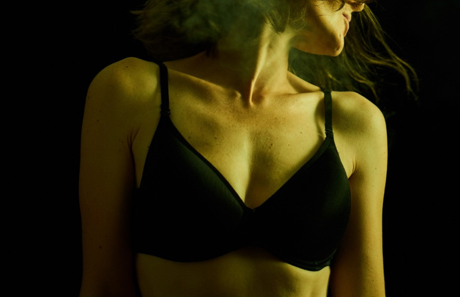 woman in a black bra looking to the left
