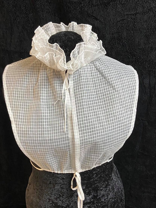 Cotton organdy chemisette, triple hand rolled ruffles.