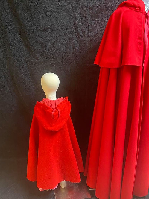 Child gently used wool cape, lined hood.