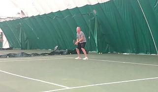 Larrs Playing Tennis