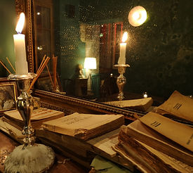 Candle%20and%20books%20on%20the%20firepl