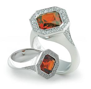 White gold garnet and diamond ring