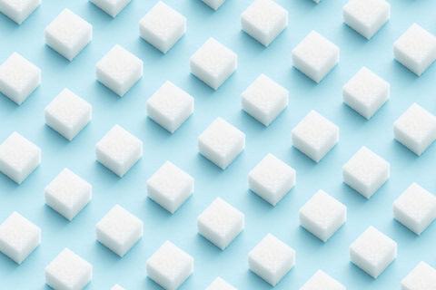 Sugar cubes pattern on light blue backgr