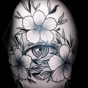 neo-traditional black and grey eye and flowers tattoo /Jacob James / tattoo shops near me / tattoo artists in Grand Junction / tattoo shops in Grand Junction