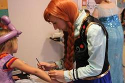 Anna Doing Glitter Tattoos Frozen