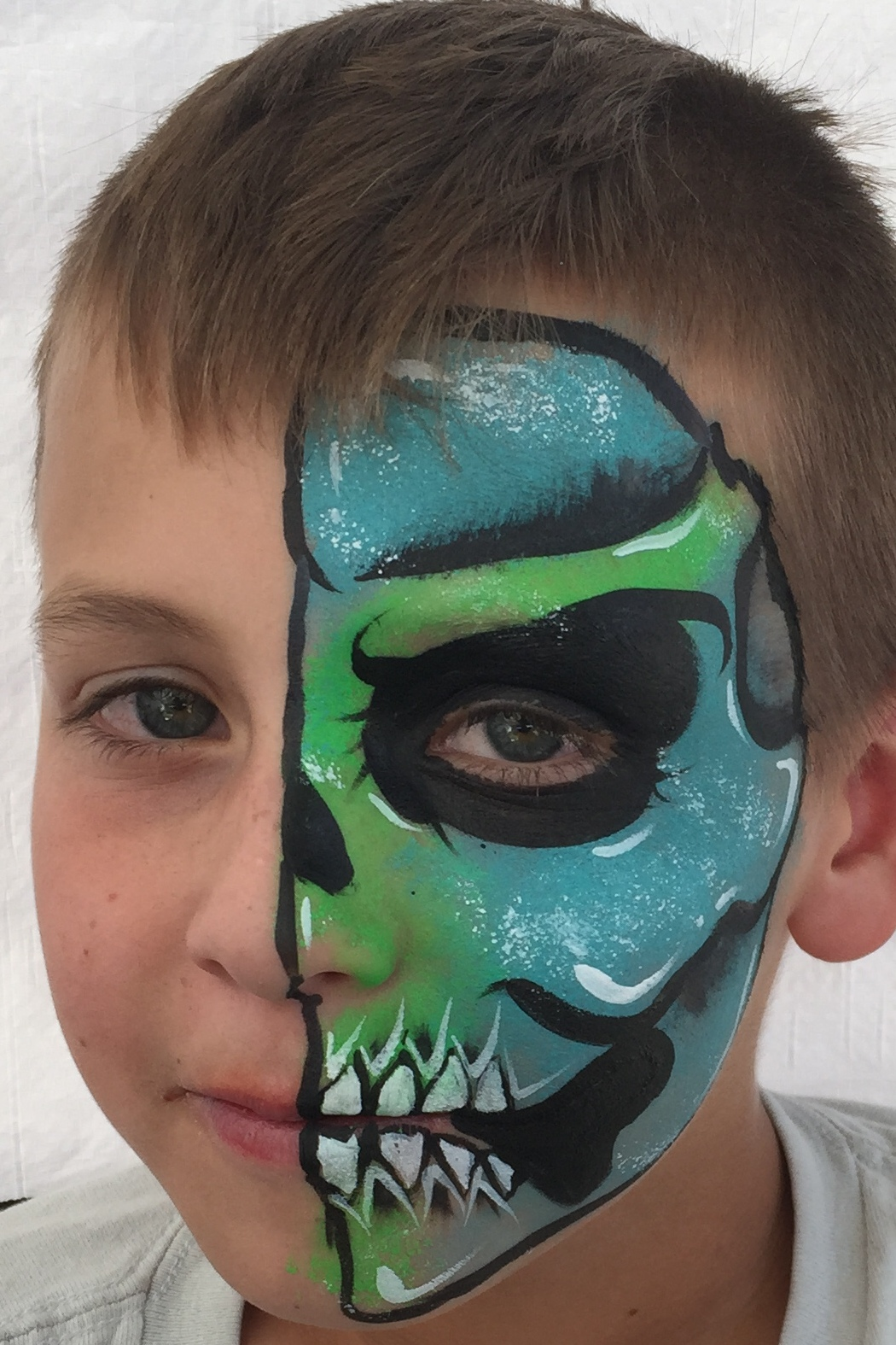 Blue and green skull boys face paint