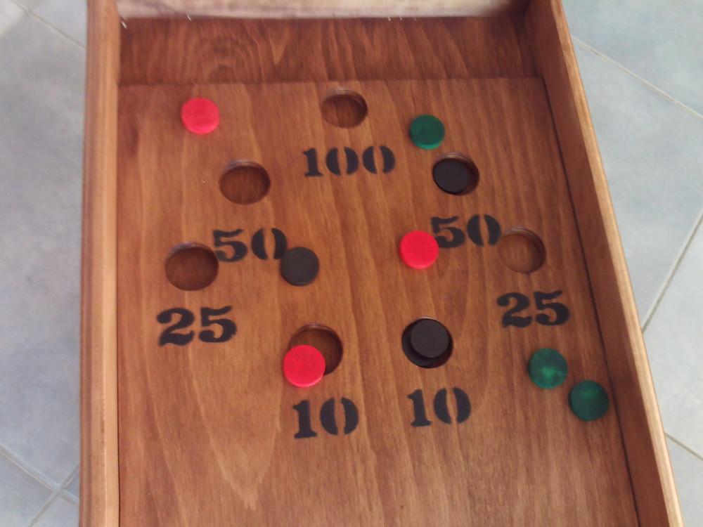 2 à 4 joueurs.  Dimensions: 122 cm x 41 cm . A partir de 5 ans.