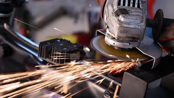 metal-worker-grinding-steelusing-grinder