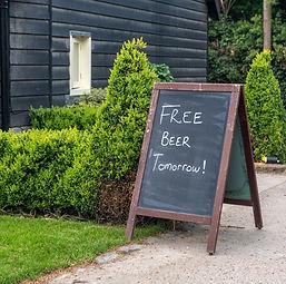 Humorous sign on blackboard outside pub