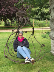Marie on a swing sculpture