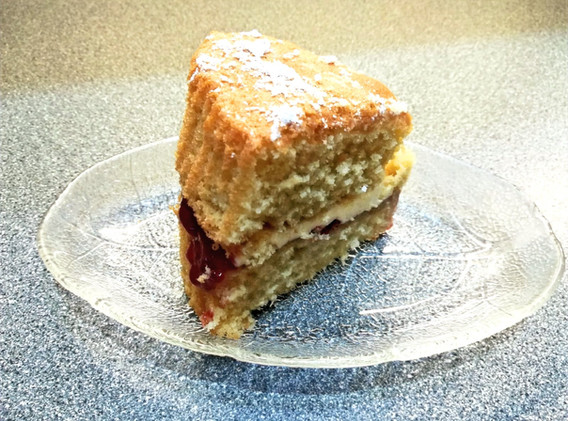 Homemade Victoria Sponge filled with Buttercream and Strawberry Jam