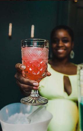 poti9n girl holding drink.jpg