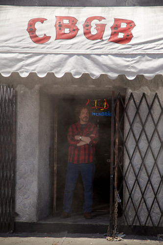 hilly in cbgb doorway photo by beau gian