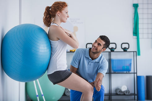 Smiling professional personal trainer he